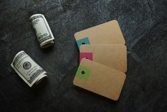 Paper tags and cash Stock Photos
