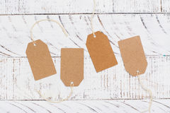 Paper tags on woodent tabel. Copy space Stock Image