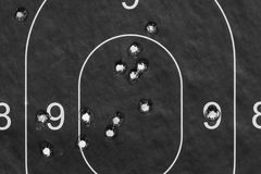 Paper target in the bullet holes Stock Photos