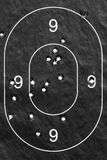 Paper target in the bullet holes Stock Images