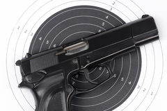 Paper target and gun. Paper target and pistol on white Stock Photo