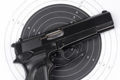 Paper target and gun Stock Photo