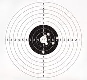 Paper target for shooting practice. With bullet holes Royalty Free Stock Photo