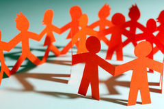 Paper team linked together partnership concept Stock Image