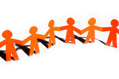 Paper team linked together partnership concept Stock Photography