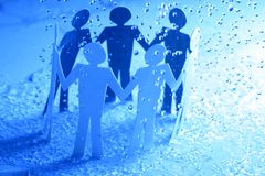 Paper team under rain Royalty Free Stock Photos
