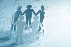 Paper team under rain Stock Image