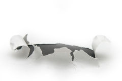 Paper tear. Tear in paper wall with black underlying layer for effects royalty free stock images