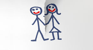 Paper Tearing Couple Apart. A white piece of paper tearing in two through a child like sketch of a man and woman holding hands stock images