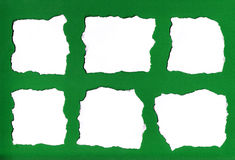 Paper tears. Collection of six white paper tears, isolated on green background for messages Stock Photography