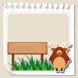 Paper template with deer on grass Royalty Free Stock Photos