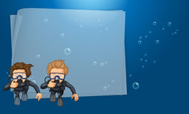 Paper template with divers in the ocean Stock Photography