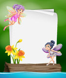Paper template with two fairies flying Royalty Free Stock Photo