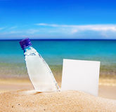 Paper for text and a bottle of water Royalty Free Stock Photo