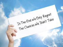 Paper with text In The End We Only Regret The Chances We Didn`t Stock Photo