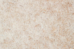 Paper texture, ecological cardboard background macro, for design with copy space text or image. Royalty Free Stock Images