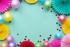 Paper texture flowers with confetti and baloons on green background. Birthday, holiday or party background. Flat lay style. Paper texture flowers with confetti stock photo