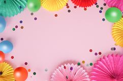 Paper texture flowers with different baloons on pink background. Birthday, holiday or party background. Flat lay style. royalty free stock photos