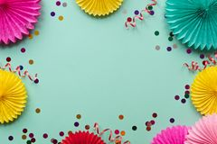 Paper texture flowers on green background. Birthday, holiday or party background. Flat lay style.  stock photos