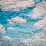 Wrinkled Paper and sky. Backgroud stock image