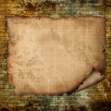 Paper texture on a grunge wall Stock Images