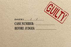Paper texture with Guilty court folder. Paper texture with Guilty rubber stamp court folder Stock Photos