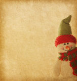 Paper texture with happy snowmen Stock Images