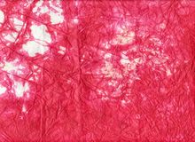 Paper texture. Red thin, crinkled paper resembling crepe, used especially for making decorations Stock Photos