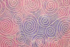 Paper texture with spiral pattern. Japanese Washi tissue with white Uzumaki pattern spirals against marbled mulberry paper royalty free stock images