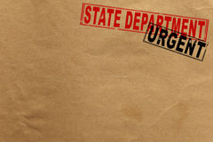 Paper texture with state department and urgent stamps Stock Photo