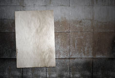 Paper on tile wall Stock Photo