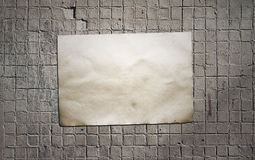 Paper on tile wall Stock Photography