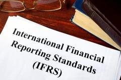 International Financial Reporting Standards IFRS. Paper with title International Financial Reporting Standards IFRS Royalty Free Stock Image