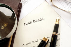 Paper with a title junk bonds. Paper with a title junk bonds and other financial documents Royalty Free Stock Images