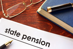 Paper with title state pension. Paper with title state pension on a table Royalty Free Stock Images