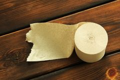 Paper. Toilet paper on wooden background stock photo