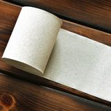 Paper. Toilet paper on wooden background stock images