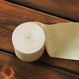 Paper. Toilet paper on wooden background stock photography