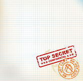 Paper with Top Secret stamps. Squared paper with Top Secret stamps  and place for your text Royalty Free Stock Photo