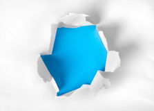 Paper torn with blue background. White paper torn with blue background royalty free stock photos