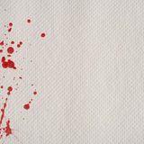 Paper towel with red blood splatters Royalty Free Stock Photos