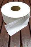Paper towel Toilet roll. White tissues roll on brown wood table Royalty Free Stock Image