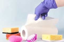 Paper towels,sponges,cleaning brush,scourer, woman in protective gloves.Concept of cleaning royalty free stock photography