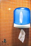 Paper towels in the toilet. Paper hand towel dispenser stock photo