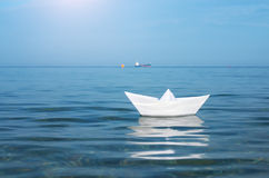 Paper toy ship and deep blue sea. Conceptual design Royalty Free Stock Images