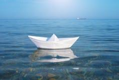 Paper toy ship and deep blue sea. Conceptual design Stock Photos