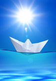 Paper toy-ship under sun Royalty Free Stock Photo