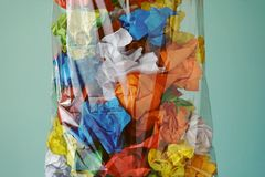 Paper trash. Sorting waste. Paper, plastic and food scraps stock images