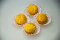 Paper tray golden yellow cake Royalty Free Stock Image