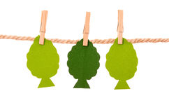 Paper trees hanging on a rope clothesline Stock Images